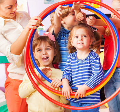 Teacher and children with hoops